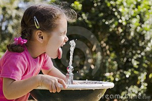young-girl-drinking-water-fountain-9300215